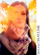 Beautiful romantic girl in a park autumn scenery. Gorgeous young woman... Стоковое фото, фотограф Zoonar.com/Arthur Mustafa / easy Fotostock / Фотобанк Лори