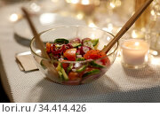 vegetable salad on table at home dinner party. Стоковое фото, фотограф Syda Productions / Фотобанк Лори