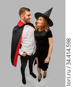 couple in halloween costumes of witch and vampire. Стоковое фото, фотограф Syda Productions / Фотобанк Лори