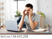 stressed man with laptop working at home office. Стоковое фото, фотограф Syda Productions / Фотобанк Лори