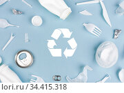 Top view of Different garbage materials with recycling symbol on blue background. Стоковое фото, фотограф Евдокимов Максим / Фотобанк Лори