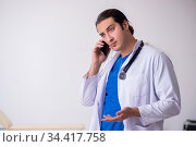 Young doctor working in the hospital. Стоковое фото, фотограф Elnur / Фотобанк Лори