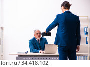 Male employee and cop in police investigation concept. Стоковое фото, фотограф Elnur / Фотобанк Лори
