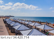 The Carcavelos beach and the fortress of Sao Juliao da Barra, near Lisbon. Portugal. Редакционное фото, фотограф Николай Коржов / Фотобанк Лори