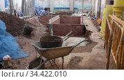 View of empty building site with brick construction, tools and materials. Стоковое видео, видеограф Яков Филимонов / Фотобанк Лори