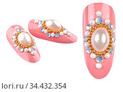 Elegant decorated pink fake nails with golden pearls and cristals... Стоковое фото, фотограф Zoonar.com/Arthur Mustafa / easy Fotostock / Фотобанк Лори