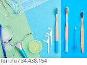 Dentist tools over blue background top view copy space flat lay. Tooth... Стоковое фото, фотограф Zoonar.com/NIKOLAY OKHITIN / easy Fotostock / Фотобанк Лори