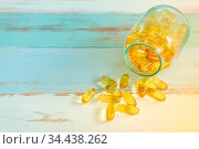 Pills medicine spilling out of pill bottle on vintage wooden background... Стоковое фото, фотограф Zoonar.com/Vichaya Kiatying-Angsulee / easy Fotostock / Фотобанк Лори