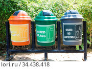 Colorful Recycle Bins In The Park, multicoloured garbage trash bins... Стоковое фото, фотограф Zoonar.com/Annebel van den heuvel / easy Fotostock / Фотобанк Лори