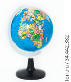 Plastic globe with Africa continent on foreground, white background. Стоковое фото, фотограф Кекяляйнен Андрей / Фотобанк Лори