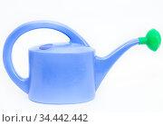 Blue watering can with green shower nozzle, white background. Стоковое фото, фотограф Кекяляйнен Андрей / Фотобанк Лори