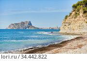 Cala Baladrar empty pebble stone beach. Costa Blanca, Spain. Стоковое фото, фотограф Alexander Tihonovs / Фотобанк Лори