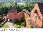 Sigulda, Latvia - AUG 16, 2020: medieval castle in Turaida on  opposite bank of  Gauja River from Sigulda. Редакционное фото, фотограф Юлия Кузнецова / Фотобанк Лори