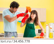 Young couple working at kitchen. Стоковое фото, фотограф Elnur / Фотобанк Лори