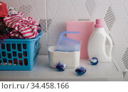 Multi-colored dirty laundry and detergents, powder and capsules. Стоковое фото, фотограф Сергей Молодиков / Фотобанк Лори