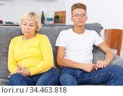 Woman and her adult son after quarrel. Стоковое фото, фотограф Яков Филимонов / Фотобанк Лори