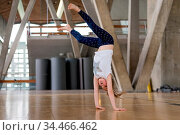 Young Caucasian girl doing cartwheel on the floor in an indoor sports... Стоковое фото, фотограф Zoonar.com/Pawel Opaska / easy Fotostock / Фотобанк Лори