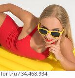Sexy blonde on swimming mattress isolated. Стоковое фото, фотограф Гурьянов Андрей / Фотобанк Лори