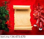 Christmas vintage scroll on red background. Стоковое фото, фотограф Zoonar.com/Ruslan Gilmanshin / age Fotostock / Фотобанк Лори