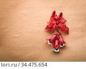 Bells and red loop on paper background. Стоковое фото, фотограф Zoonar.com/Ruslan Gilmanshin / age Fotostock / Фотобанк Лори