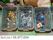 Various components from dismantled electronic equipment waiting to... Стоковое фото, фотограф Zoonar.com/Arthur Mustafa / easy Fotostock / Фотобанк Лори