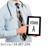 Doctor, isolated on white backgroun, holding digital tablet - Vitamin... Стоковое фото, фотограф Zoonar.com/Micha Klootwijk / age Fotostock / Фотобанк Лори