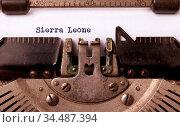 Inscription made by vintage typewriter, country, Sierra Leone. Стоковое фото, фотограф Zoonar.com/Micha Klootwijk / age Fotostock / Фотобанк Лори