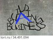Building a business written on a chalkboard, isolated. Стоковое фото, фотограф Zoonar.com/Micha Klootwijk / age Fotostock / Фотобанк Лори