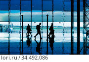 Modern building and people silhouettes. Стоковое фото, фотограф Zoonar.com/Ruslan Gilmanshin / easy Fotostock / Фотобанк Лори