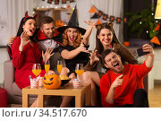 happy friends in halloween costumes taking selfie. Стоковое фото, фотограф Syda Productions / Фотобанк Лори