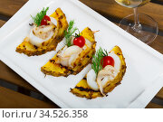 Sepia, grilled with pineapple and cherry tomatoes with sweet-sour sauce. Стоковое фото, фотограф Яков Филимонов / Фотобанк Лори