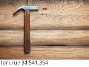 Claw hammer on the brown wooden background. Стоковое фото, фотограф Zoonar.com/Ruslan Ropat / age Fotostock / Фотобанк Лори