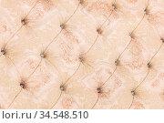 Beige soft tapestry pattern background with symmetrical buttons on... Стоковое фото, фотограф Zoonar.com/Ian Iankovskii / easy Fotostock / Фотобанк Лори