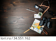 Travel plan background. Traveler accessories and items on wooden background... Стоковое фото, фотограф Zoonar.com/Alex Veresovich / easy Fotostock / Фотобанк Лори
