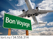 Bon Voyage Green Road Sign and Airplane Above with Dramatic Blue ... Стоковое фото, фотограф Zoonar.com/Andy Dean Photography / age Fotostock / Фотобанк Лори