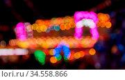Viele defokussierte bunte Lichter auf Jahrmarkt oder Kirmes abends. Стоковое фото, фотограф Zoonar.com/Robert Kneschke / age Fotostock / Фотобанк Лори