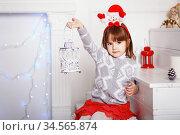 Portrait of a beautiful little girl with Festival Snowman Decorative Christmas Headband on head. Стоковое фото, фотограф Nataliia Zhekova / Фотобанк Лори