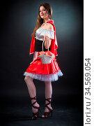 Beautiful woman in carnival costume. Little Red Riding Hood shape... Стоковое фото, фотограф Zoonar.com/Figurniy Sergey / age Fotostock / Фотобанк Лори