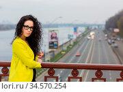 A beautiful girl is on a bridge outdoor. Стоковое фото, фотограф Zoonar.com/Figurniy Sergey / age Fotostock / Фотобанк Лори