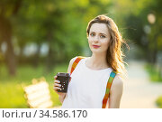 Portrait of lovely urban girl with paper cup in her hands. Стоковое фото, фотограф Nataliia Zhekova / Фотобанк Лори