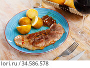 Fried pork on bone with boiled potatoes in their skins. Стоковое фото, фотограф Яков Филимонов / Фотобанк Лори