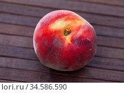 Delicious ripe peaches fruit on wooden surface in kitchen. Стоковое фото, фотограф Яков Филимонов / Фотобанк Лори
