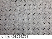Grey felt material background with dark dots. Стоковое фото, фотограф Яков Филимонов / Фотобанк Лори