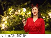 happy woman in red halloween costume of devil. Стоковое фото, фотограф Syda Productions / Фотобанк Лори
