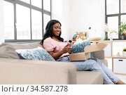 african american woman with cosmetics at home. Стоковое фото, фотограф Syda Productions / Фотобанк Лори