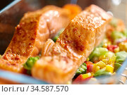 salmon fish in baking dish on kitchen table. Стоковое фото, фотограф Syda Productions / Фотобанк Лори