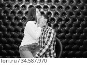 Young couple in love hug each other on the black background. Стоковое фото, фотограф Nataliia Zhekova / Фотобанк Лори
