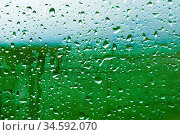 Natural background Drops on both sides of the glass from the rain... Стоковое фото, фотограф Zoonar.com/Ian Iankovskii / easy Fotostock / Фотобанк Лори