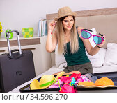 Young woman getting ready for summer vacation. Стоковое фото, фотограф Elnur / Фотобанк Лори