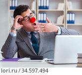 Clown businessman tired sleepy in the office. Стоковое фото, фотограф Elnur / Фотобанк Лори
